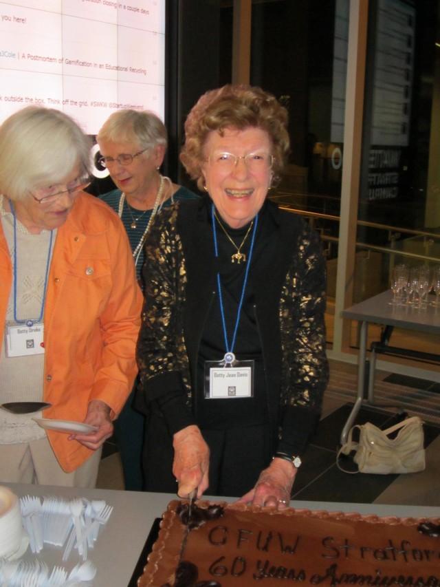 Betty Jean Davis cuts the 60th Anniversary cake.