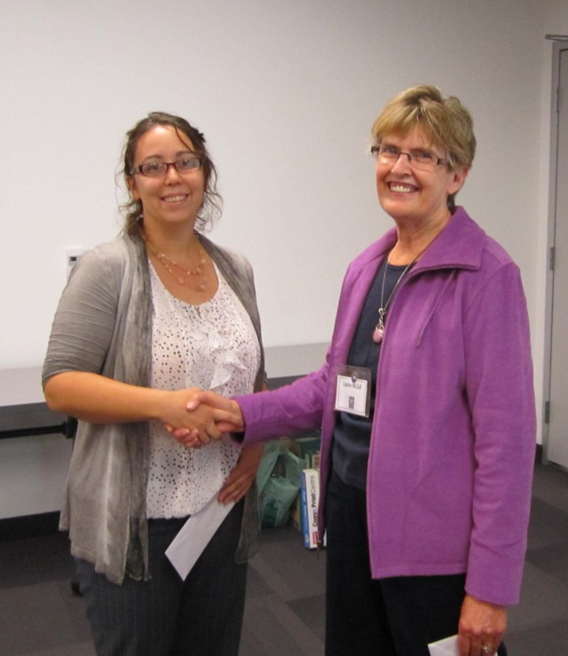 PRESENTATION OF MATURE STUDENT SCHOLARSHIP AWARD. Laura Blaine recipient and Louise McColl, CFUW Stratford Scholarship Chair.