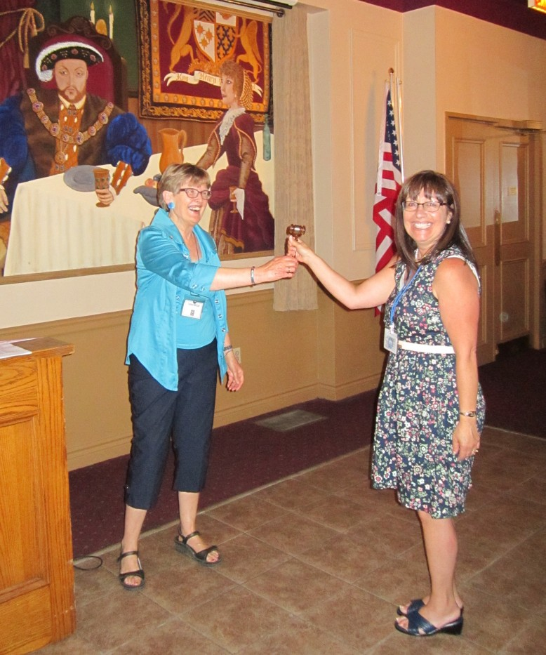 Louise McColl passes the gavel to incoming Club President Charlotte Gillette