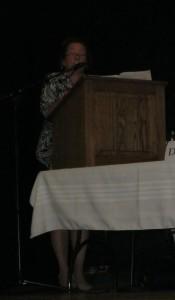 Charlene Gordon moderates the debate.